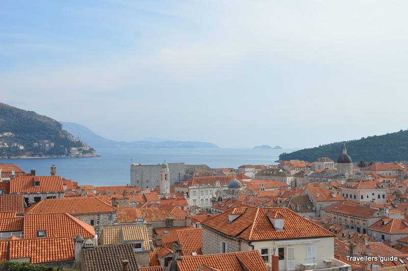 The red-tiled roof and blue Adriatic- amusing combination